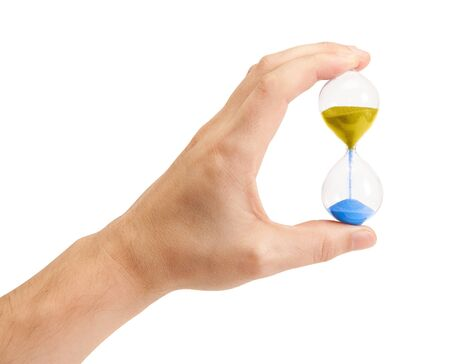 Hand holding an hourglass isolated on white background photo