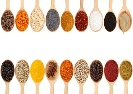 spices: Collection of 18 spices on a wooden spoon  isolated on a white background
