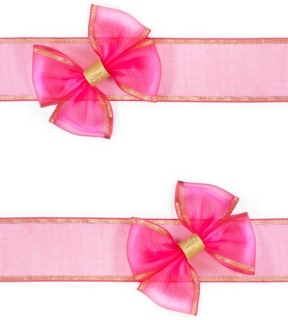 bow knot: pink bow on the ribbon isolated on white background Stock Photo