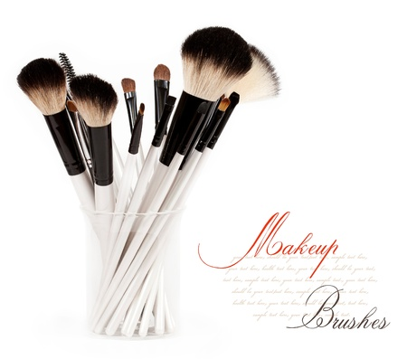 makeup brush set in a glass beaker isolated on white background Stock Photo