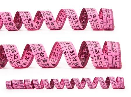 cintas metricas: una cinta de medir. aisladas sobre fondo blanco