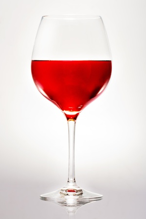 Glass of red wine. isolated on a white background photo