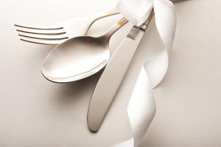 dinnerware: cutlery - knife, spoon and fork tied ribbon
