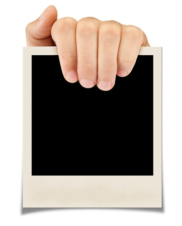 A hand holding a photograph  isolated on a white background photo