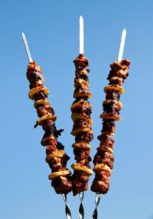 drie spiesjes shish kebab in de lucht photo