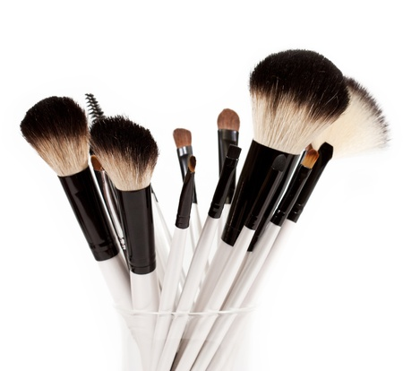 brush in: makeup brush set in a glass beaker isolated on white background Stock Photo