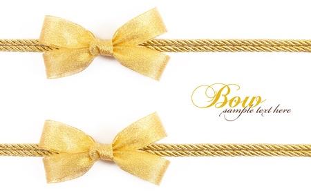 fiocco oro: fiocco oro isolato su sfondo bianco