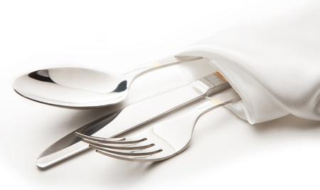 cuchillo y tenedor: cubiertos - cuchillo, cuchara y tenedor cinta atada Foto de archivo
