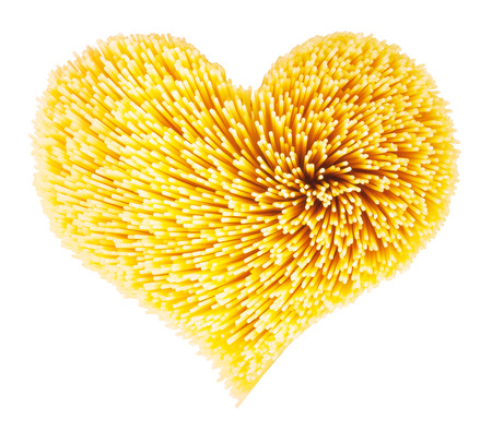 Dry spaghetti in the shape of heart photo