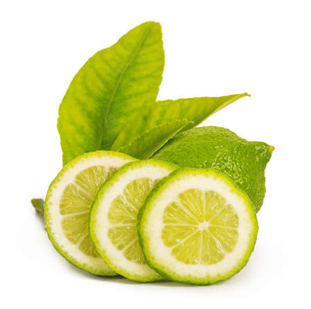 lime: Juicy, beautiful lime with leaves isolated on white background Stock Photo