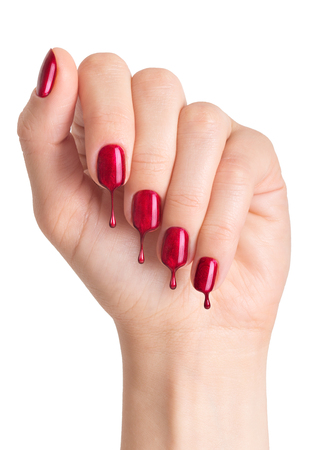 polish: Female hand with painted nails. Nail polish dripping on nails