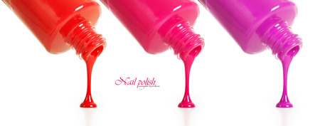 red nail colour: Three types of nail polish pouring from a bottle