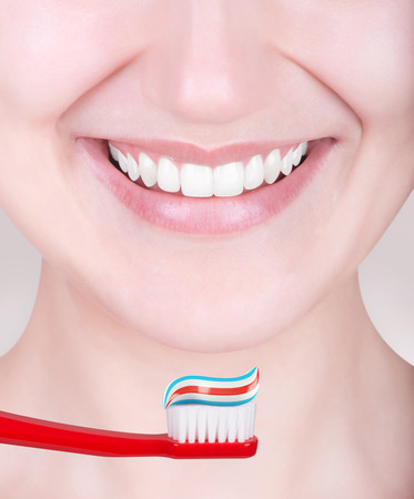 perfect teeth: Woman with perfect teeth and toothbrush