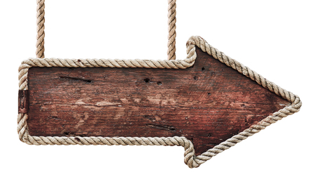 Old wooden road signboard. Arrow sign hanging on ropes. Isolated on white background Stock Photo