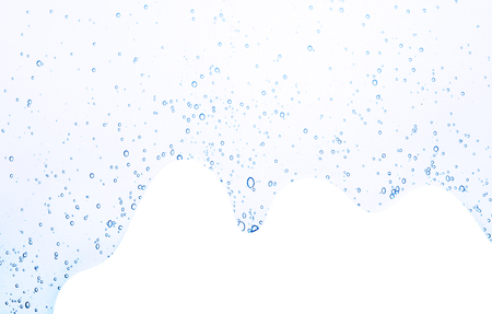 Oxygen bubbles in clear blue water, close-up. Mineral water. Water enriched with oxygen. The concept of ecologically clean sea, environment.