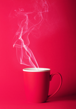Fragrant coffee on a pink background for your advertising. Smoke from hot coffee.