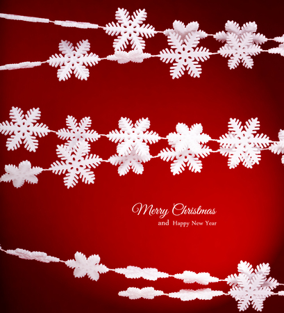 Greeting Card Happy New Year and Merry Christmas. Background of snowflakes.