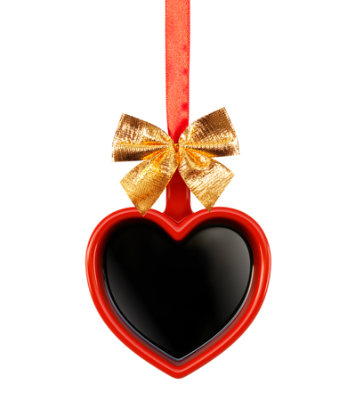 Cup in the shape of a heart. Aromatic coffee on a white background for your advertising. Valentine's Day postcard