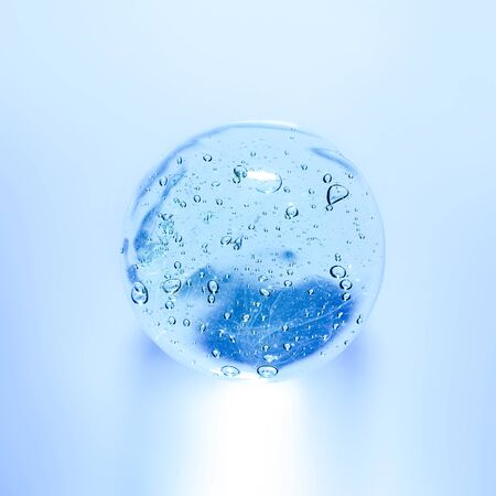 Transparent gel with bubbles close-up. Smear of face gel cream. The texture of gel cream. A sample of a cosmetic product.