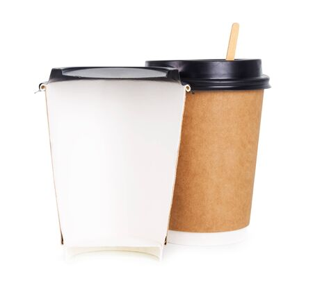 Takeaway coffee in a paper cup. Creative coffee advertising, paper cup in the cut. Advertising coffee.