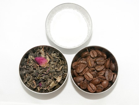 Natural tea, coffee and sugar in small bowls photo