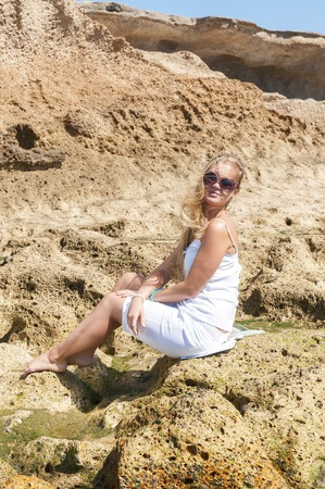 blondy:  Blondy girl in white with sunglasses on the beach  Tenerife