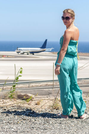 blondy: Beautiful blondy with long hair looking at airplane  Tenerife