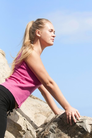 rapelling: Fitness  Young woman training on a mountain Stock Photo