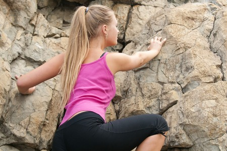 rapelling: Young woman climbing on the rock