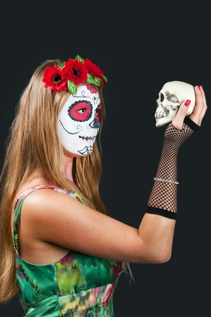 Girl with Calavera Mexicana makeup mask photo