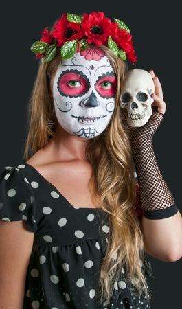 Girl with Calavera Mexicana makeup mask photo