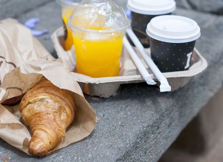 Croissant breakfast with coffee and orange juice to take away Stock Photo