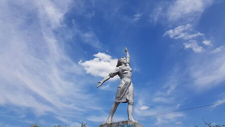 Worker woman historic monument on blue sky with white clouds background. Social realism sculpture in Odessa region of Ukraine