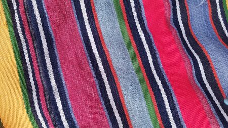 Striped traditional floor mat with bright colorful stripes. Turkish striped carpet background. Woven texture. Ethnic pattern rug. Traditional Asian ornaments. Weaved textured backdrop Stockfoto