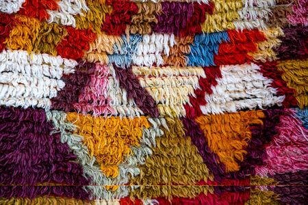 Bright fluffy carpet with rhombus pattern. Turkish ornamental carpet background. Woven texture. Ethnic pattern rug. Traditional Asian ornaments. Turkish bazaar backdrop Standard-Bild