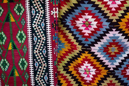 Ethnic rhombus and zigzag ornate carpets. Turkish ornamental mats background. Woven texture. Ethnic pattern rug. Traditional Asian ornaments. Turkish bazaar backdrop