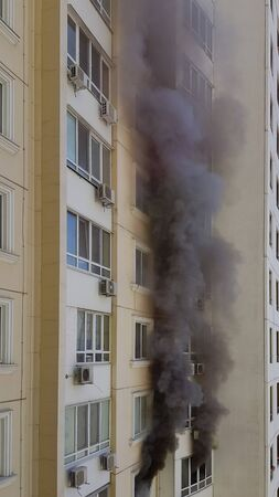 Huge black smoke of condominium house in fire. Accident due arson in protests 版權商用圖片
