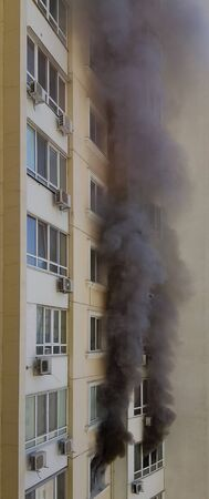 Wall of building with  black smoke of fire accident. Arson in protests