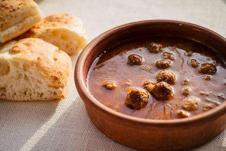 Traditional turkish food kofta is meatballs in tomato sauce and bread on the white table. Cappadocia. Turkey