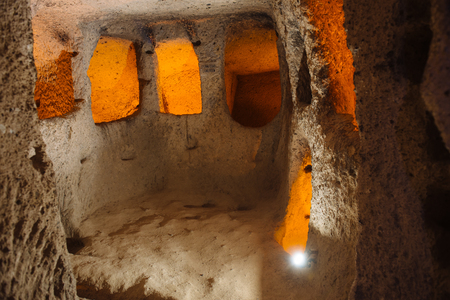Interior of Kaymakl? underground city, passage, stables, cellars, storage rooms. Caves are popular tourist attraction in Cappadocia, Turkey