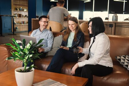 Business discussion of freelancers in co-working. Team working in relaxed, informal atmosphere of office Фото со стока