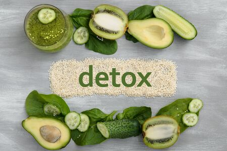 Word detox made on sesame seeds. Green smoothy, fresh vegetables, leafs. Concept of diet, weight loss, healthy eating
