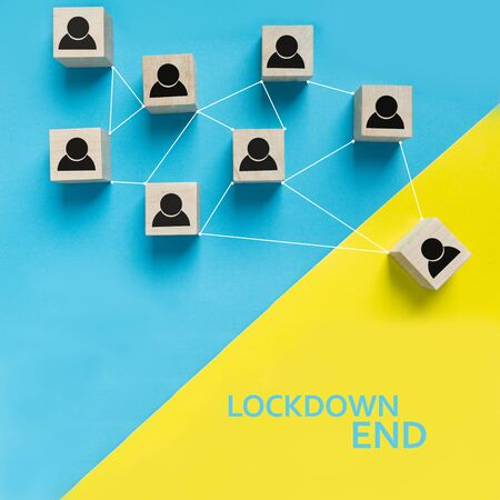 Lockdown end after Covid-19, back to normal life and social contacts. Concept made of wooden building blocks. Stay safe in new world