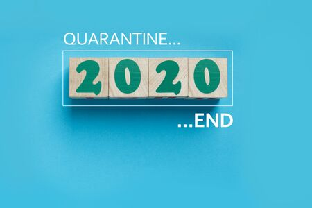 Quarantine 2020 End, lock down finish and back to new normal life, reopening of business concept. Flat lay wooden blocks on blue background with copy space