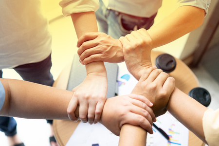 Business man holding hands cross over each other as team of success