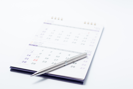 written date: a pen on calendar concept for an important day or reminder