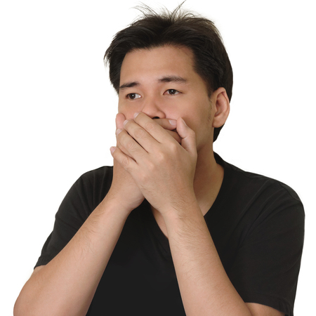 Asian Man Covering Mouth with Two Hands