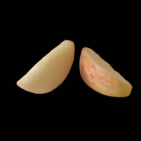 Isolated Two  Sliced Apple Piece on Black Background