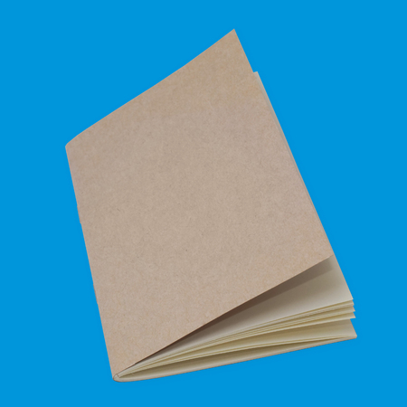 sketchbook: Isolated Closed Sketchbook on Blue Background