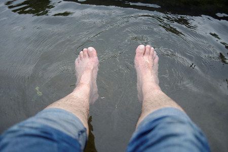 human toe: Foot of a Man in Hot Spring Water, Relaxation Stock Photo